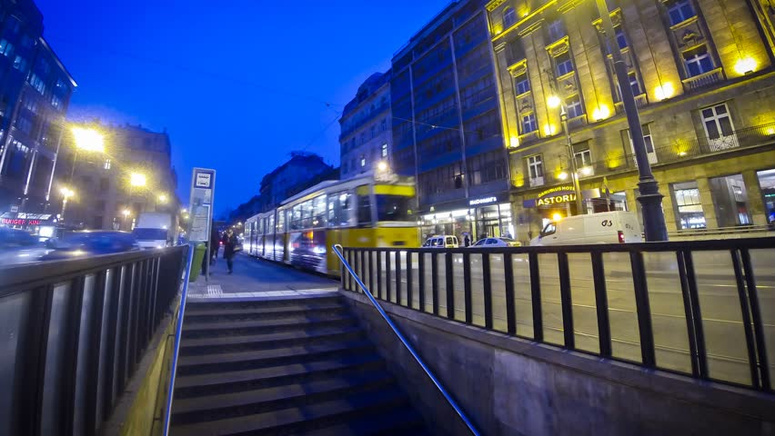 BUDAPEST, HUNGARY - JANUARY 28, 2014: People walking near the tram stop in Budapest city (Time Lapse). Budapest tram network is one of world's largest tram networks, operating on 157 km of total route