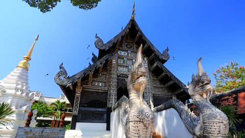 CHIANG MAI, THAILAND - CIRCA FEB 2014: Tourists visit Wat Chedi Luang temple. Wat Chedi Luang is a Buddhist temple in the historic centre of Chiang Mai, Thailand
