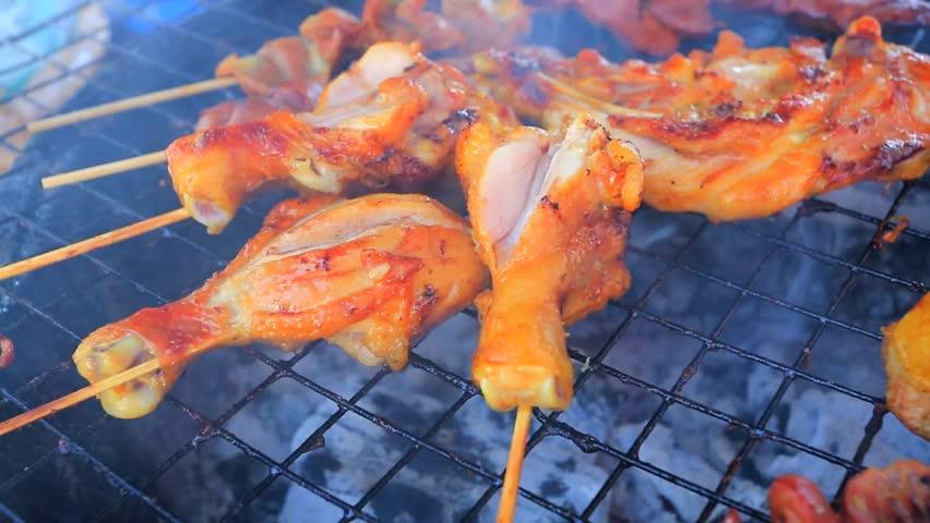 Close up shot of grilling chicken legs   Shutterstock HD Video #5636894