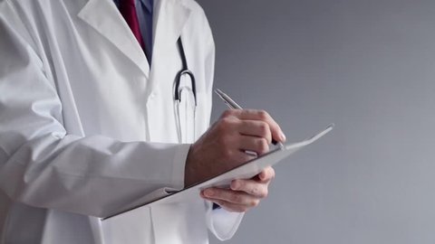 Doctor Filling Out a Medical Stock Footage Video (100% Royalty-free)  31866391 | Shutterstock