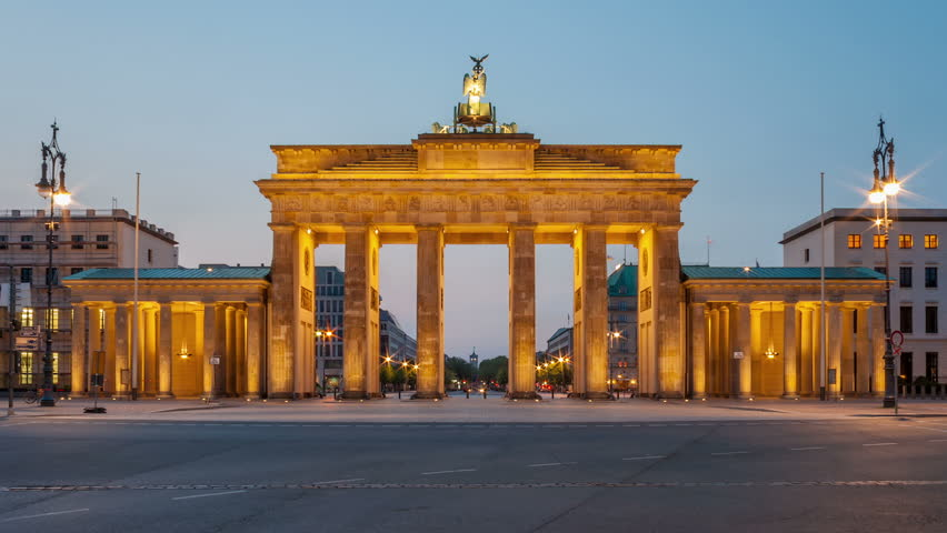 Sunrise over Brandenburg Gate in Berlin. Time lapse from dawn to daylight