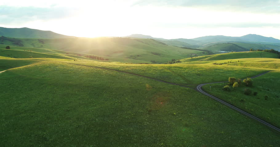 Aerial View. Car on a winding road in the hills. Altai Mountains, Siberia, Russia. Summer 2013