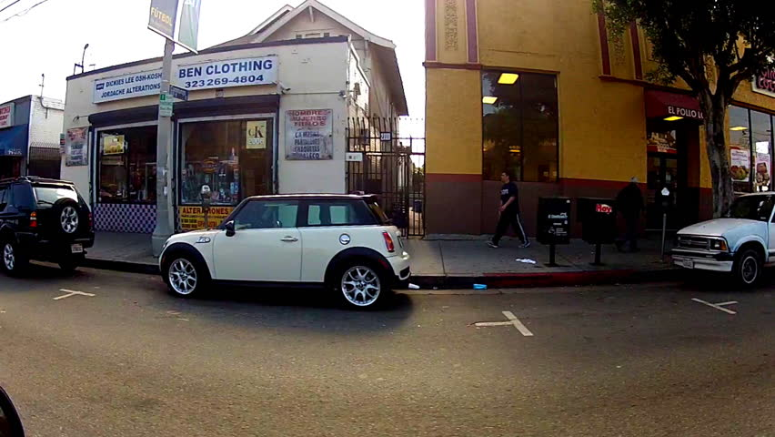 LOS ANGELES, CA: February 12, 2014- Vehicle drive by shot of small businesses on Cesar Chavez Boulevard circa 2014 in Los Angeles. Shops and store fronts along a popular East Los Angeles street.