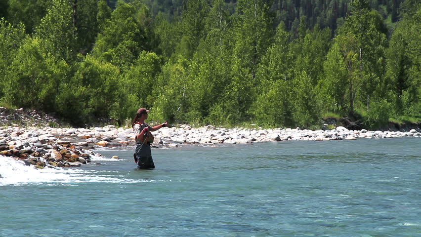Spinningists in Action. Casting fly fishing at a mountain river           #5667743