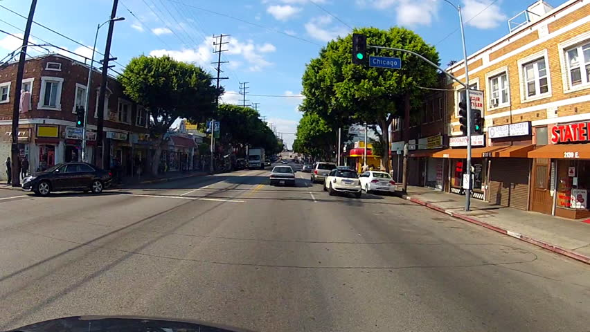 LOS ANGELES, CA: February 12, 2014- POV driving on Cesar Chavez Boulevard circa 2014 in Los Angeles. Features the drive along this east Los Angeles street with local Latino shops and eateries.