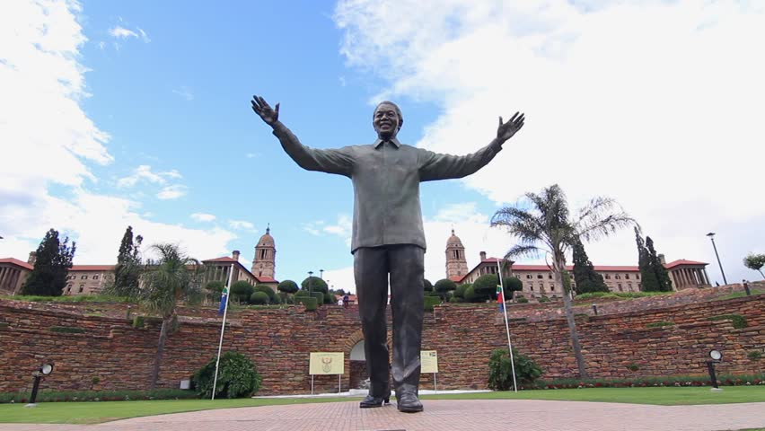 PRETORIA, SOUTH AFRICA - FEBRUARY 2014 - A giant statue of Nelson Mandela holds out his hands with the Union Building in the background. The statue was unveiled on December 16 2013 by President Zuma.