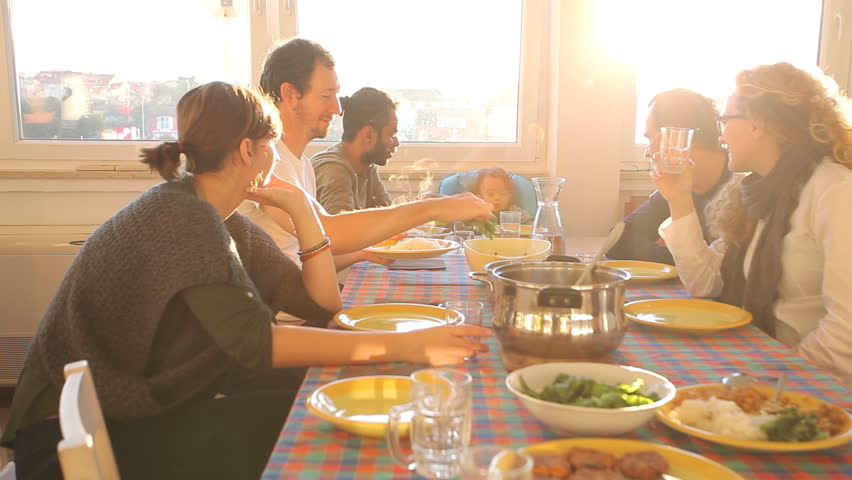 Group of friends eating lunch at home with flare | Shutterstock HD Video #5693747