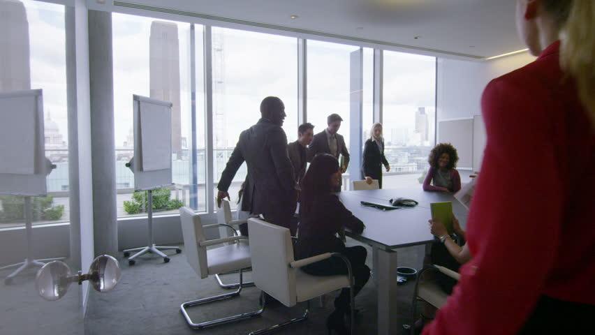 Corporate business team in boardroom meeting in London city office. In slow motion. | Shutterstock HD Video #5699828