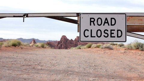 Road closed sign in mountain area
