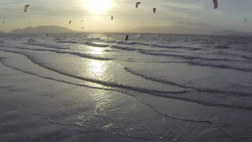 LR aerial pan of a kite surfer riding fast at sunset    Shutterstock HD Video #5719136