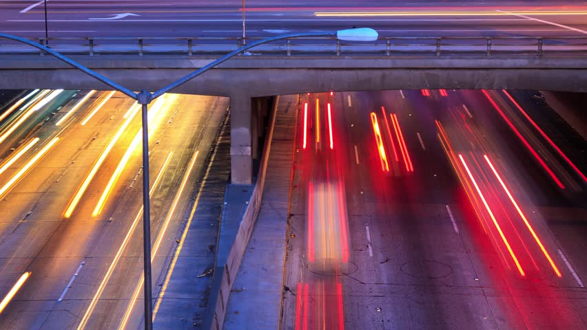 4K timelapse of traffic in Los Angeles city. Pan up, zoom out.