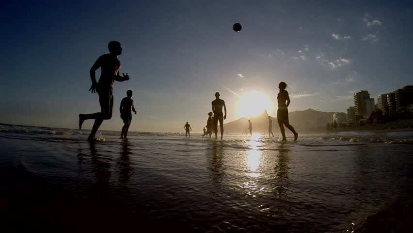 Silhouettes of Carioca Brazilians playing beach football at sunset on Ipanema Beach Rio de Janeiro Brazil silhouetted slow motion | Shutterstock Video #5731385