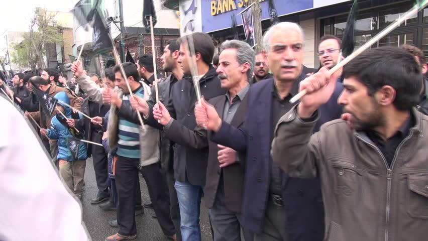 ZANJAN, IRAN - 13 NOVEMBER 2013: People take part in a procession to mark the martyrdom of Hussain, as part of Ashura, in Zanjan, Iran   Shutterstock HD Video #5739065