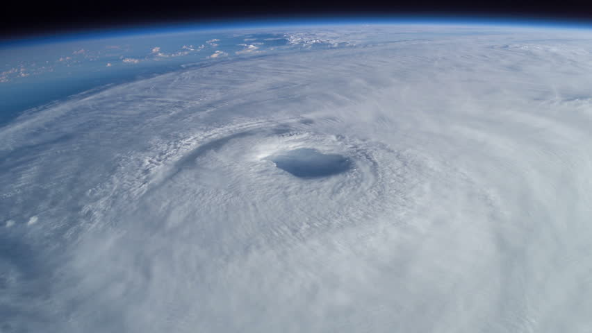 Huge Rotating Hurricane from Space (with visible eye). Perfect for videos: hurricanes, typhoons, storms, low pressure, eye of the storm, hurricane hunters. hurricane harvey, hurricane irma