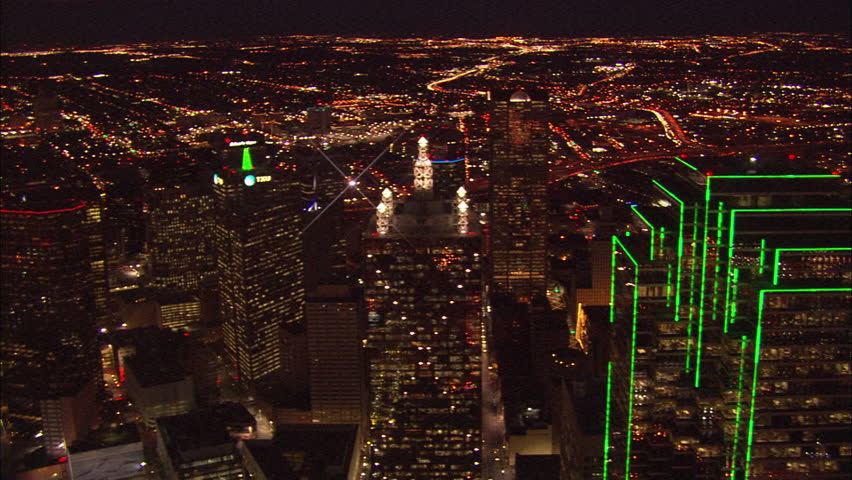 Lights Dallas Skyline. Bright Dallas City lights shining through the night.