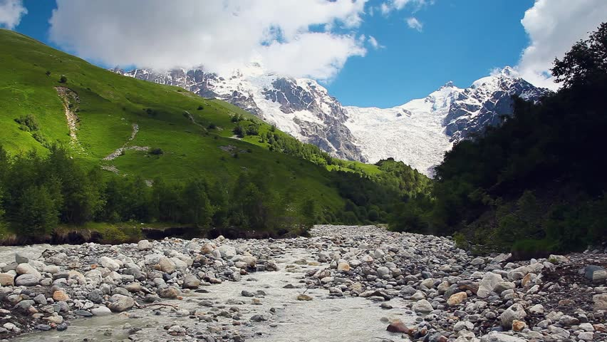 River in mountain valley at the foot of Tetnuldi glacier. Upper Svaneti, Georgia, Europe. Caucasus mountains. Beauty world. HD video clip (High Definition).