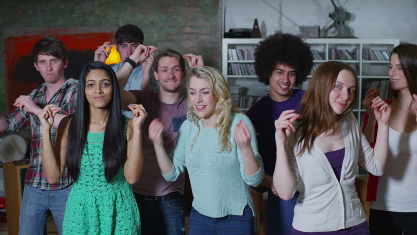 Carefree group of young friends dancing together at a house party #5762531
