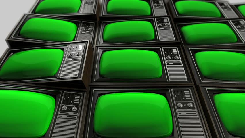 A pan across a group of vintage wood plastic and chrome television that are displaying a green screen | Shutterstock HD Video #5763047