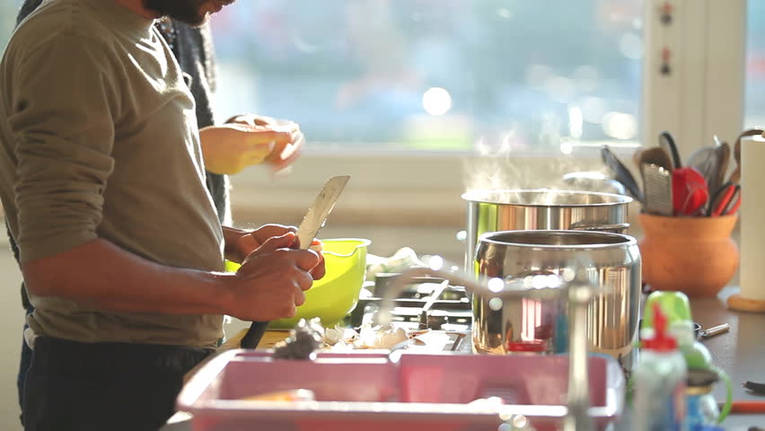 multiethnic couple cooking in a spacious kitchen