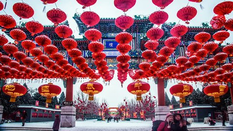 The decorated archway and red lanterns in the snow