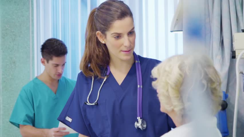 Medical staff working together and taking care of patients on a hospital ward.    Shutterstock HD Video #5783147