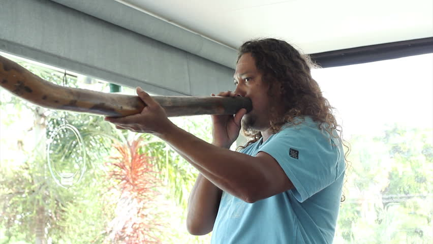 PORT DOUGLAS, AUSTRALIA - FEB 28: Linc Walker of the Kuku Yalanji tribe demonstrates the Didgeridoo on Feb 28, 2014 in Port Douglas, Australia.  The Kuku Yalanji people are native to North Queensland