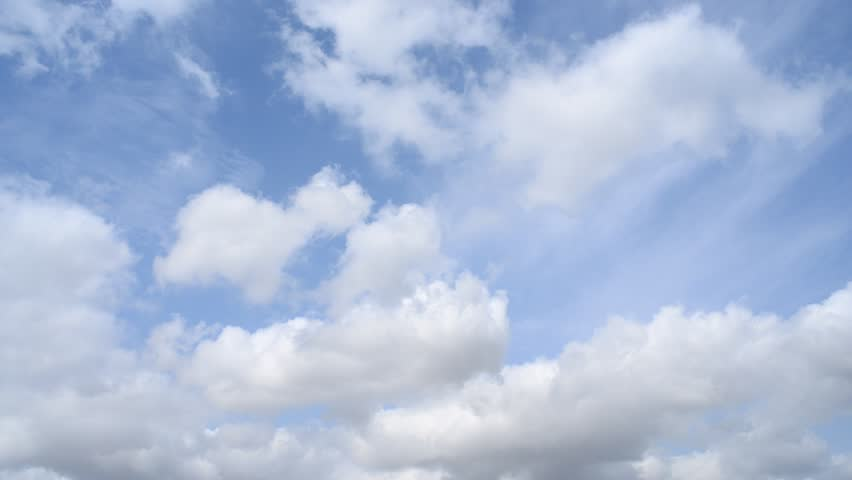 Time lapse clip of white fluffy clouds over blue sky.Timelapse fx HDV 1080p. | Shutterstock HD Video #5792051