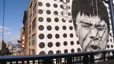 NEW YORK - CIRCA MARCH 2013: Black and white mural on the side of a building in New York City on a sunny day. Traffic passes by in the background.