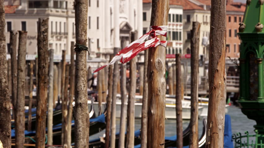 Slow motion shot of wooden docking posts for gondolas