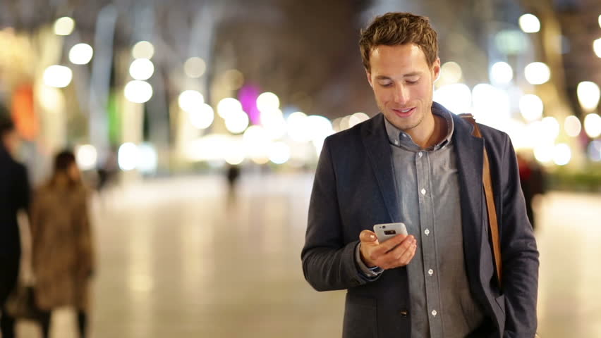 Smartphone man talking on smart phone at night on La Rambla in Barcelona. Handsome young business man talking on mobile cell phone smiling happy wearing suit jacket outdoors. | Shutterstock HD Video #5808233