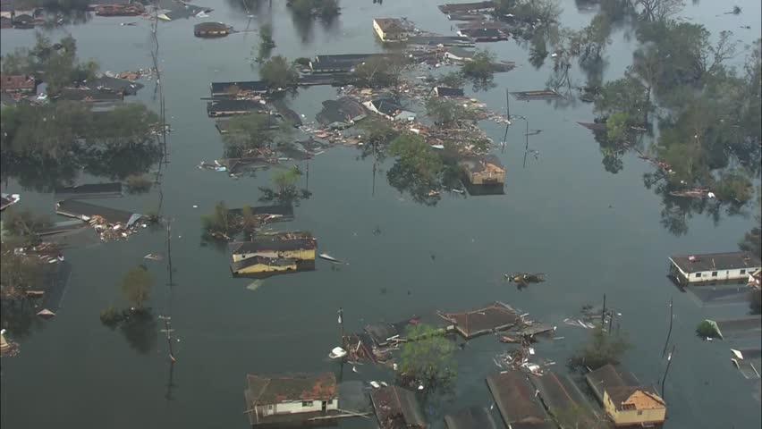 Hurricane Katrina Flood Damage. The sun rises over neighborhood that has been flooded and destroyed by Hurricane Katrina. Damage from the storm is severe.