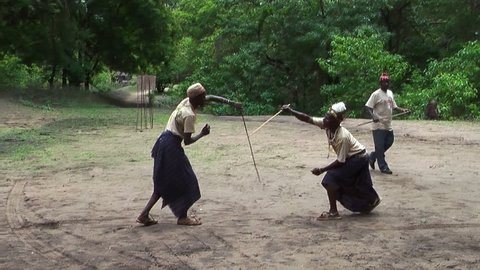 NGORONGORO, KIGALI, TANZANIA - CIRCA DEC, 2011: People of Masai tribe perform fighting with sticks due art performance. The Maasai are ethnic group of semi-nomadic people in Tanzania