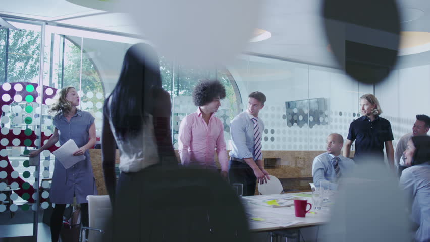 Attractive mixed ethnicity business team in a boardroom meeting. | Shutterstock HD Video #5847251