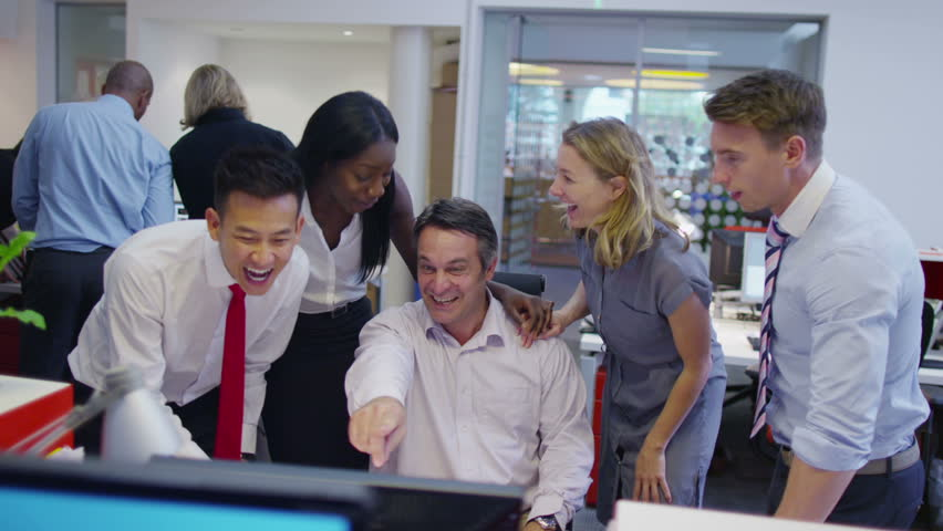 Happy diverse business group looking at a computer screen are pleased with their success. | Shutterstock HD Video #5853512