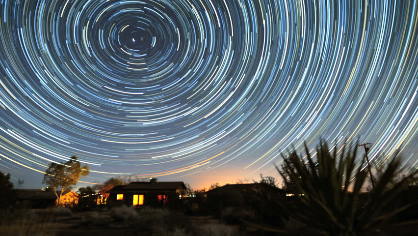 4K Star Trails Night Sky Cosmos Galaxy Time-lapse over Cabin. Sunrise from night to day in amazing high resolution at Joshua Tree National Park, California.