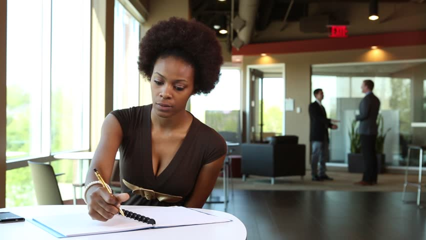 African American Business Woman Gets Up From Desk Royalty-Free Stock Footage #5869139