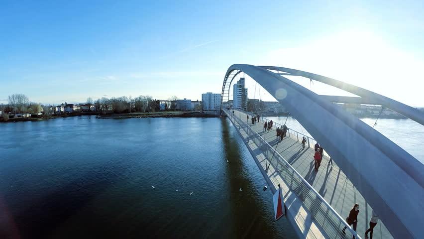 Fly over bridge. aerial view. sunset sky. people walking on bridge. 1920x1080
