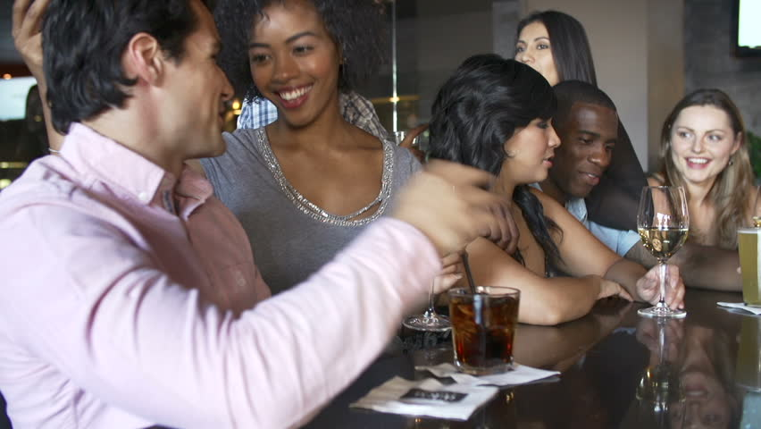 Camera tracks along bar as group of young friends enjoy a night out.Shot on Sony FS700 in PAL format at a frame rate of 25fps | Shutterstock HD Video #5876453