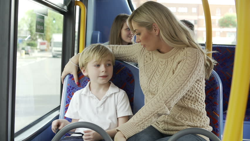 Mother talking to son during bus journey to school.Shot on Sony FS700 in PAL format at a frame rate of 25fps