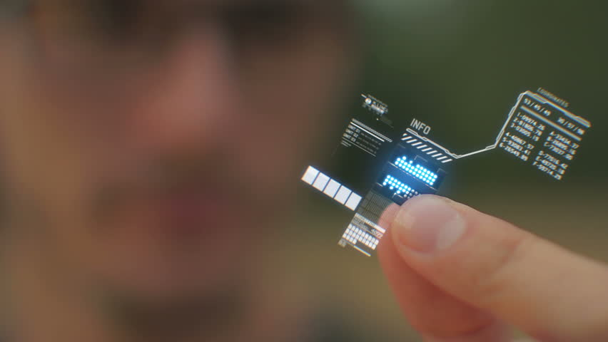 Shot of a person holding a computer processor with a holographic interface. | Shutterstock HD Video #5892701