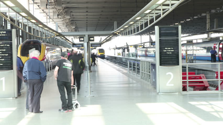 Time lapse of travelers and commuters passing through London's St. Pancras railway station. #5899448