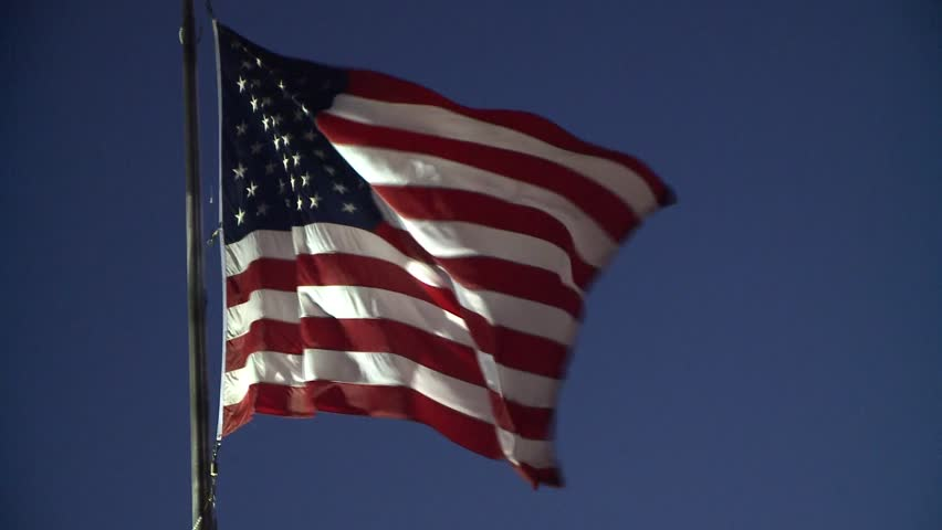 AMERICAN FLAG USA WAVING IN WIND LONG :30 SECOND CLIP HIGH DEFINITION STOCK VIDEO FOOTAGE REAL TIME 1920X1080 HD