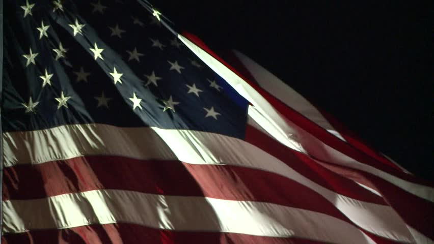 AMERICAN FLAG USA WAVING LITE AT NIGHT IN WIND LONG :30 SECOND SLOW MOTION CLIP HIGH DEFINITION STOCK VIDEO FOOTAGE REAL TIME 1920X1080 HD