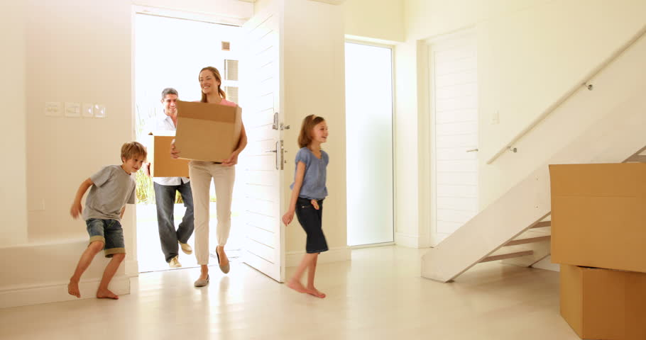 Happy family moving into their new home in their new home #5932340