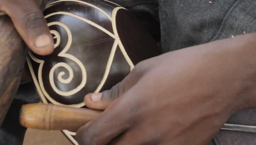 AFRICAN ART,Close up of a man caving
