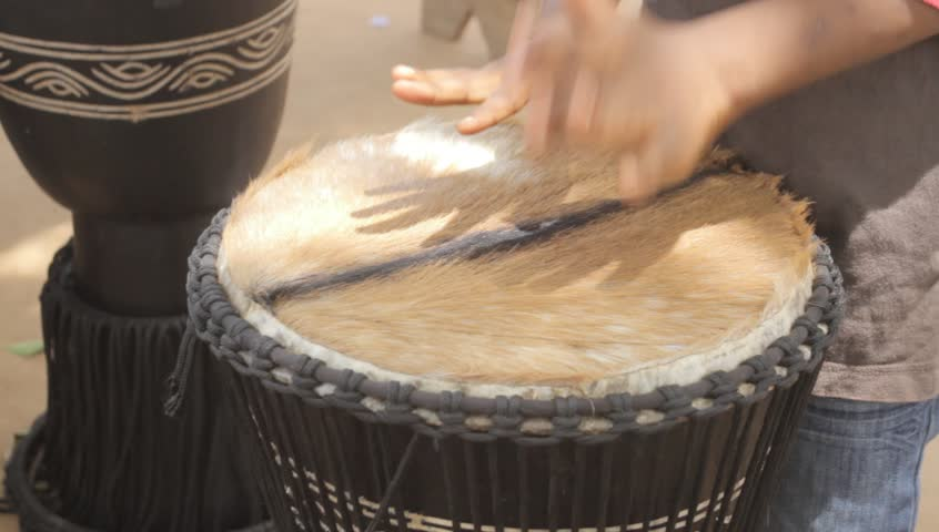 AFRICAN ART,Close up of a child playing drum