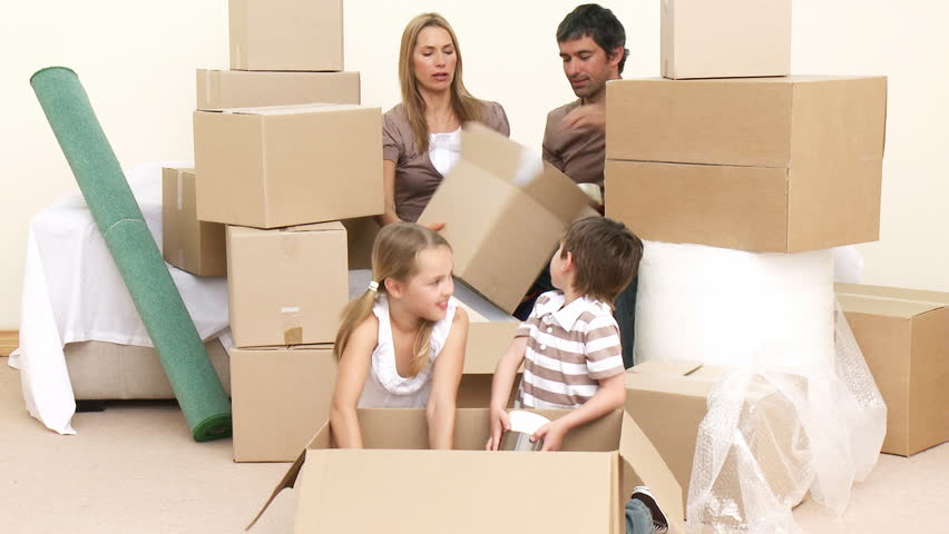 Family moving house. Parents and children unpacking boxes. Footage in high definition  #598543