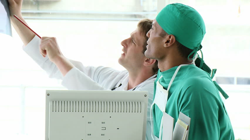 Footage in high definition of medical team examining an x-ray