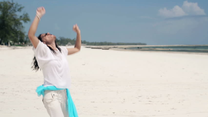 Happy young woman playing, having fun on exotic beach  | Shutterstock HD Video #5994416