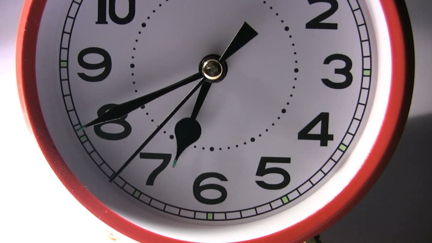 Tilt up to the ringing bells of a red clockwork alarm clock. | Shutterstock HD Video #6001715